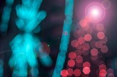 Grande rojo del día de fiesta de la Navidad y azul defocused que brilla festivo Fotos de archivo libres de regalías