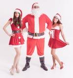 Grande Santa avec filles chaudes, amie Image libre de droits