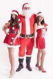 Grande Santa avec filles chaudes, amie Images stock