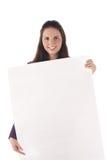Grande segno in bianco sorridente della holding femminile (isolato) Fotografia Stock