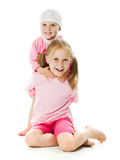 Grande soeur, étreindre de petite soeur Photo stock