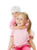 Grande soeur, étreindre de petite soeur Photo libre de droits