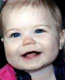Grande sorriso e grandi guancie Fotografia Stock