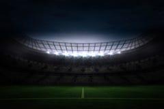 Grande stadio di football americano sotto cielo notturno fotografia stock
