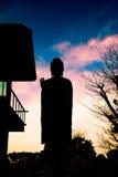 Grande statua di Buddha in siluetta Fotografia Stock