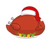 Grande tacchino dell'arrosto in cappuccio di Santa Claus Gallinacei di Natale su spirito del piatto illustrazione di stock