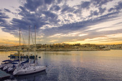 Grande tramonto del porto Immagini Stock