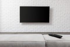 Grande TV sur le mur blanc photos stock