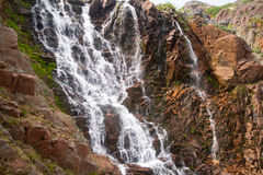 Grandes belles cascades du nord sur le bord de la mer Photos stock