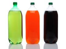 Grandes bouteilles de bicarbonate de soude sur le blanc image libre de droits