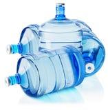 Grandes bouteilles de l'eau sur le fond blanc Photo libre de droits