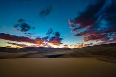 Grandes dunas de arena después de la puesta del sol Colorado Imagen de archivo libre de regalías