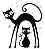 Grandes et petites silhouettes de chats Image stock