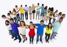 Grandes personnes de groupe tenant le concept d'amitié de main Photographie stock