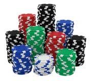 Grandes piles de puces de casino d'isolement sur le blanc Image stock