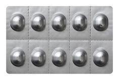 Grandes pilules dans l'enveloppe de boursouflure d'aluminium argenté Images libres de droits