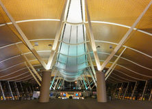 Grandeur in airport. Angles support curves in the columns and ceiling expanse of the Shanghai Pudong airport in China Royalty Free Stock Photos