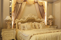 Golden bed royalty free stock photography
