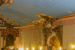 Grandeur in decay. Decaying interior of grand 1920's era movie theater with painted walls and ceiling Royalty Free Stock Photo