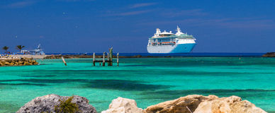 Grandeur of the Seas cruise ship was tendered next to the shore. Coco-Cay Island Stock Photo