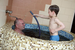 Grandfaher and grandson in jacuzzi Royalty Free Stock Photography