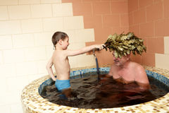 Grandfaher and grandson refreshing in jacuzzi Stock Image