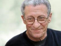 Grandfather. A portrait of a smiling senior man stock photos
