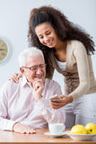 Grandfather and adult granddaughter Royalty Free Stock Photo