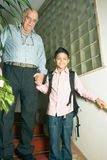 Grandfather And Grandson In Stairwell-Vert Stock Photography