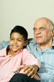 Grandfather And Grandson Sitting - Vertical Stock Image
