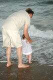 Grandfather with baby in sea stock photo