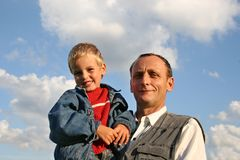 Grandfather with boy stock images