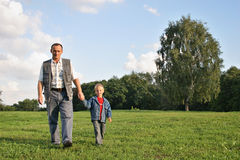 Grandfather and boy walking Royalty Free Stock Images