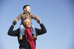 Grandfather Carrying Grandson On His Shoulders Royalty Free Stock Images