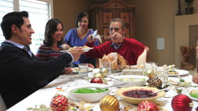 Grandfather Carving Turkey At Family Thanksgiving Meal Stock Photo