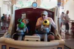 Grandfather and child on carnival ride amusement park royalty free stock photo