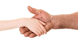 Grandfather and child handshake Royalty Free Stock Images