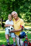 Grandfather and child have fun  in park Royalty Free Stock Images