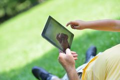 Grandfather and child in park using tablet Royalty Free Stock Photos