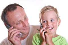 Grandfather and child with phones Stock Image