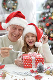 Grandfather and child in Santa hats Stock Photos