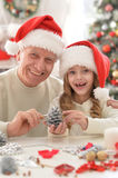 Grandfather and child in Santa hats Royalty Free Stock Images