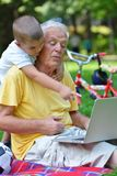 Grandfather and child using laptop Royalty Free Stock Images
