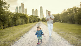 Grandfather and Child. Grandfather and Child walking at the Park in front of Skyline Royalty Free Stock Images