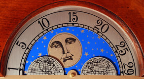 Grandfather Clock Calendar Moon Globe. A detail of a grandfather clock showing the days of the month, the man in the moon, and the globe Royalty Free Stock Photos