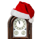 Grandfather clock and cap of Santa Claus, isolated on white back Royalty Free Stock Photography