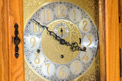 Grandfather Clock Face and Oak Case Royalty Free Stock Photography