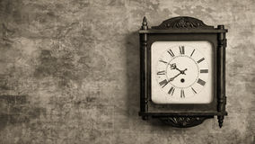 Grandfather clock hanging on a wall Royalty Free Stock Images