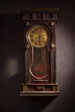 Grandfather clock hanging on a wall Stock Images