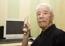 Grandfather and computer Stock Image